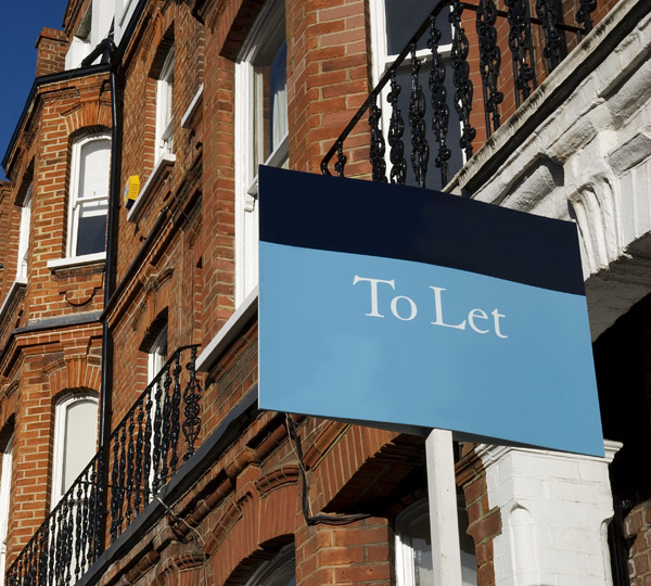 "Townhouses with ""To Let"" sign"